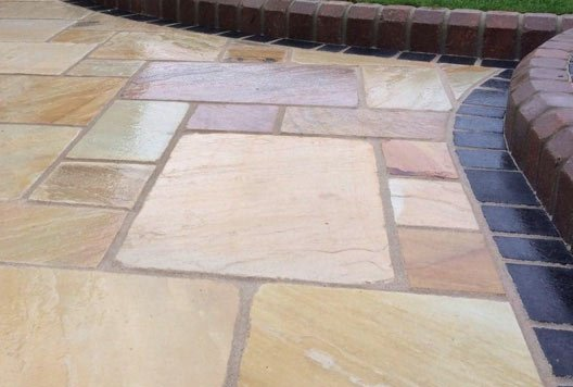 Paving in a residential back garden, installed by our pavers