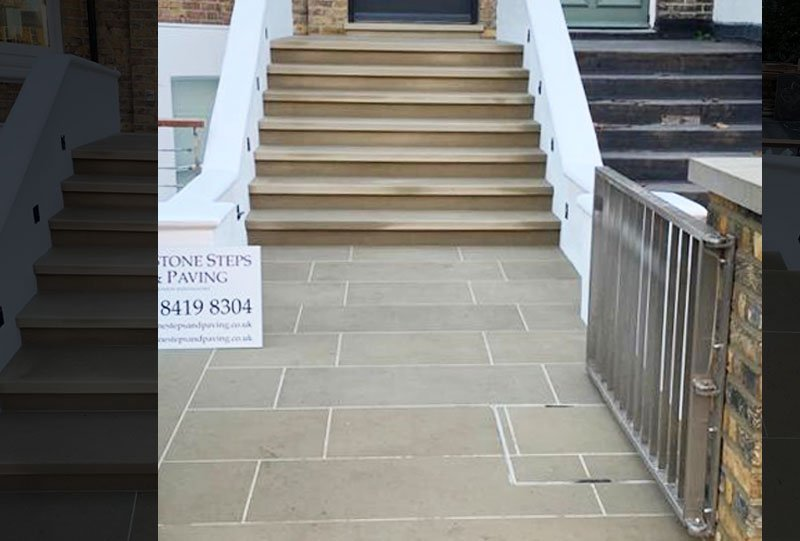 Stone front door steps and paving